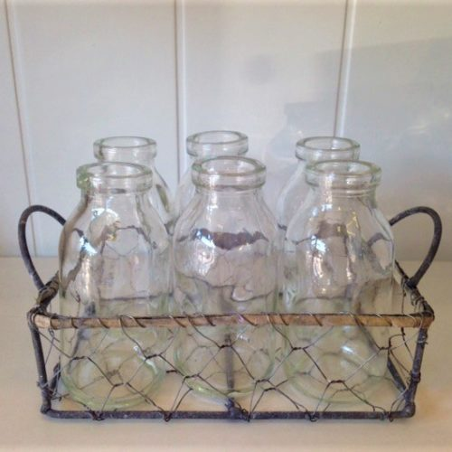 6 milk bottles in wire basket