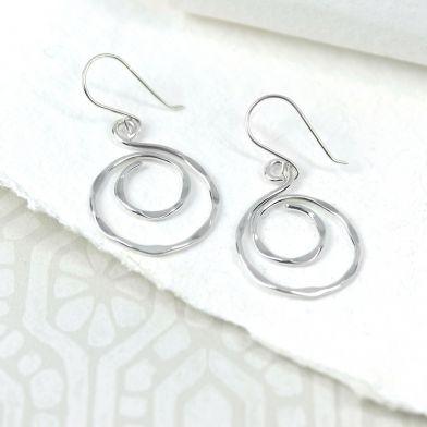 pom silver swirl earrings
