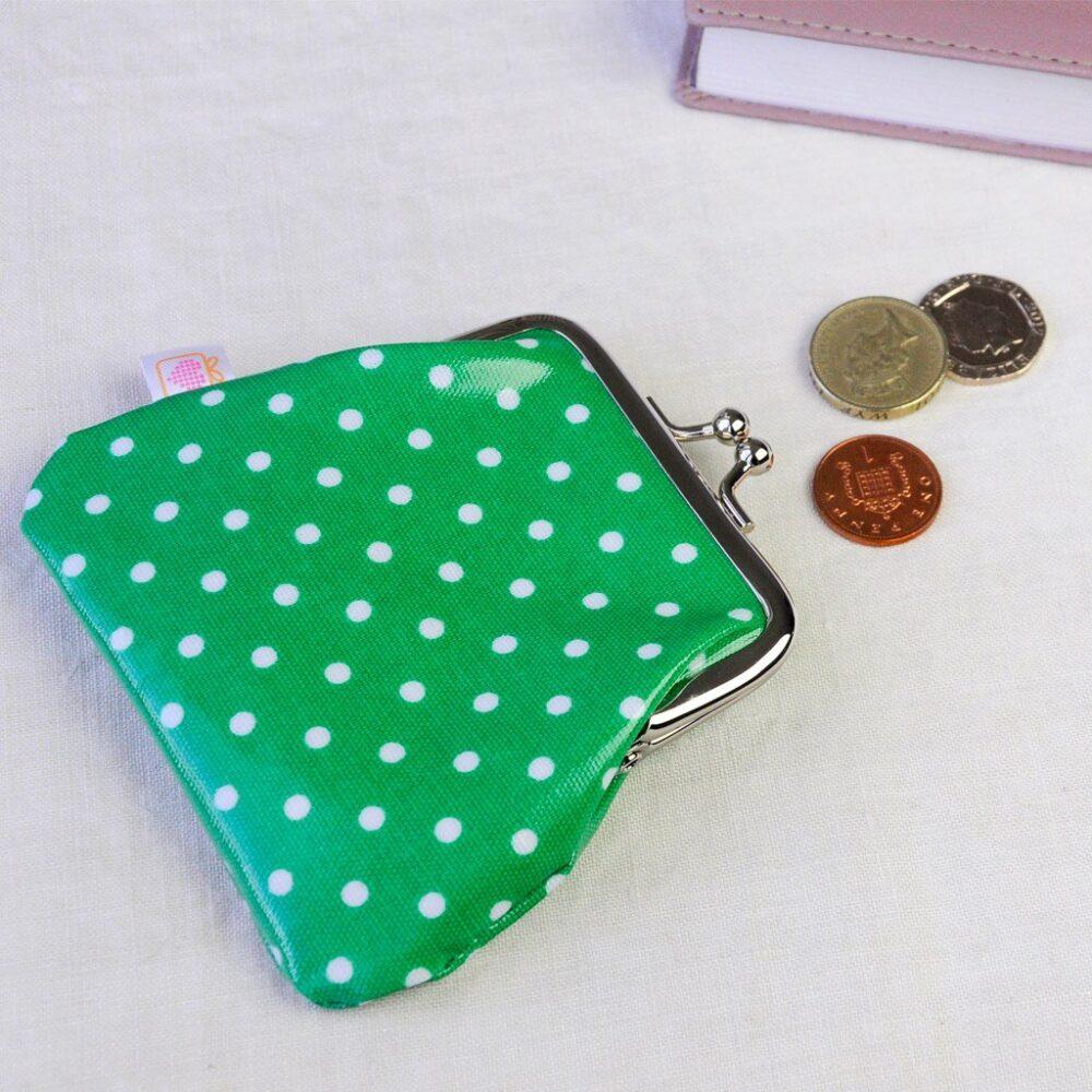 green spotty purse